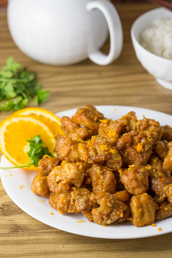 Orange Chicken served with orange slices and orange zest