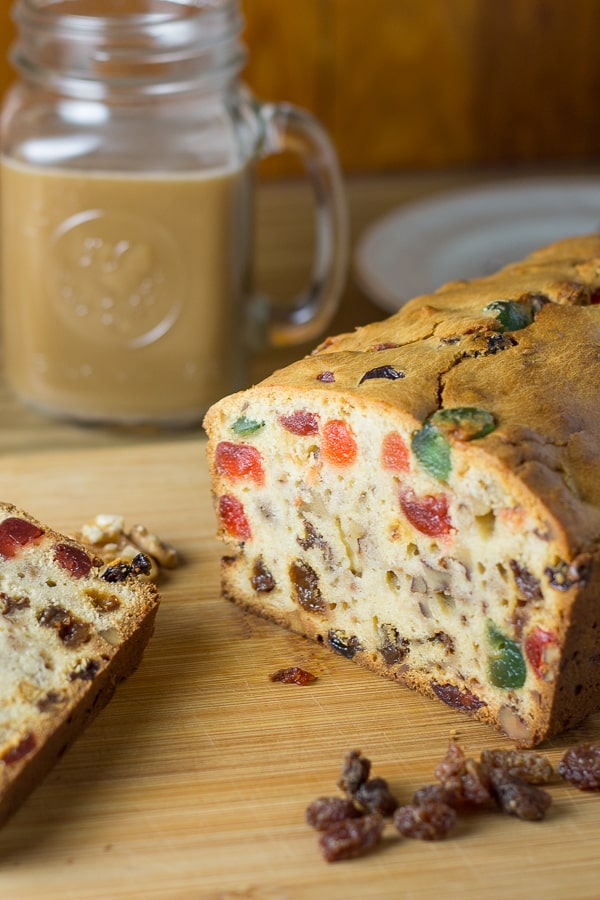 Fruitcake - cross section with a cup of coffee in the background